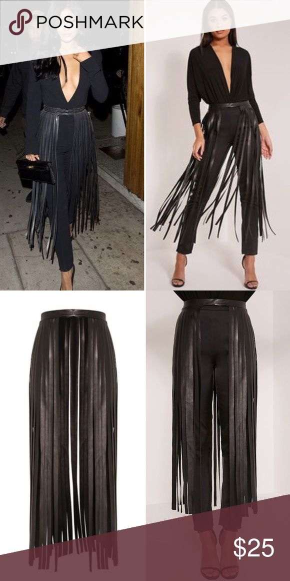 """Black Faux Leather Fringe Belt This sexy faux leather fringe belt is very close to the one worn by Kylie Jenner. Slip on style, elasticized waist measures 27"""" but can stretch to 28"""", fringe length from waist down is 35"""", model height is 5'9"""". Pair this statement belt with a black bodysuit, leggings and stilettos to complete your look! NWT PLT Accessories Belts"""