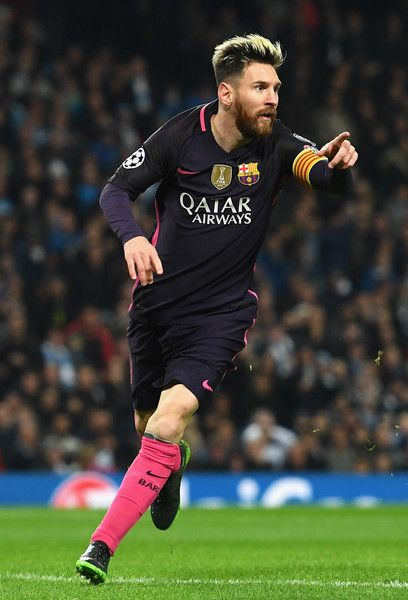 Lionel Messi of Barcelona celebrates scoring his sides first goal during the UEFA Champions League Group C match between Manchester City FC and FC Barcelona at Etihad Stadium on November 1, 2016 in Manchester, England.