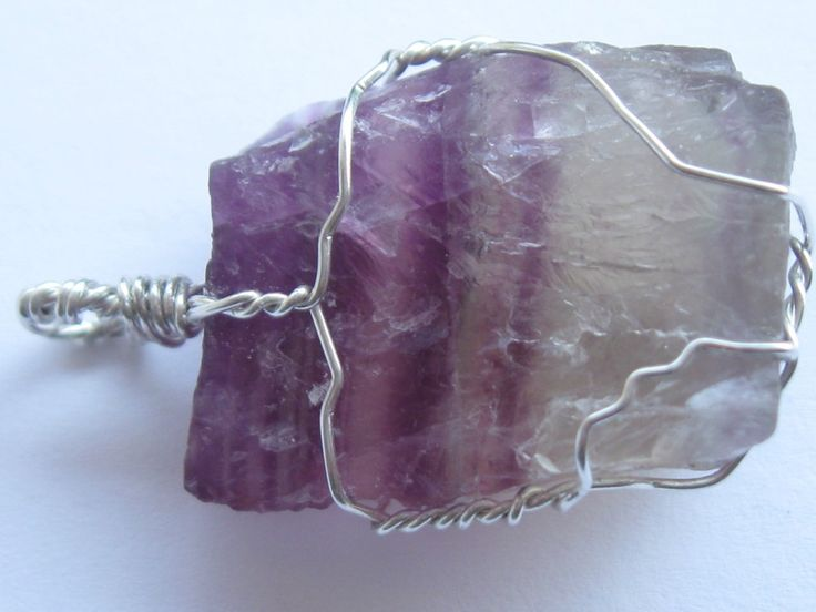 Raw fluorite crystal pendant wire wrapped in sterling silver