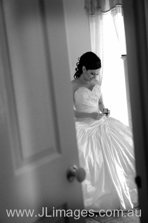 The subtle but powerful moment of the bride having a glimpse at her beautiful ring. Check out this photograph of the beautiful bride with her ring. #jlimages #weddingphotography #photography #wedding #candid