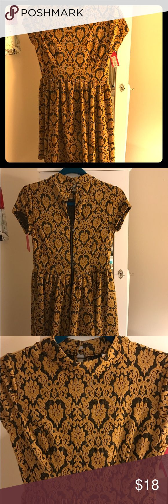 Brand new tapestry patterned mini dress. Bell mini dress with high neck and capped sleeves. It's super soft cotton and looks dressy or casual. Dresses Midi