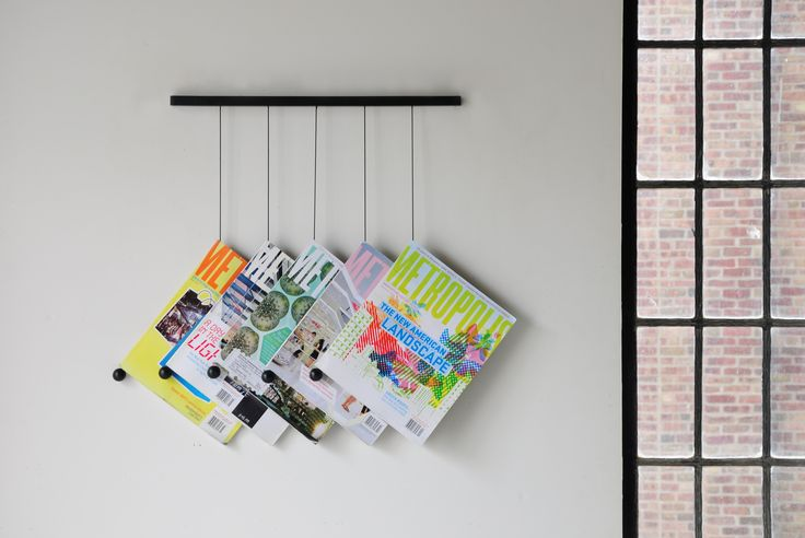 An interesting way to store magazines/books that let me see all covers at once... When stored the old-fashioned way you mess it all around just to find what you are looking for, that according to Murphy's Law, is always the last thing taken from the shelf.