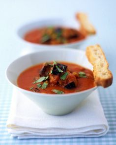 Roasted Tomato and Eggplant Soup | Martha Stewart Living - Roasting vegetables revs up their flavor -- it also works wonders for the chickpeas in this soup. Slices of toasted rustic bread and chopped cilantro make for a restaurant-worthy bowl.
