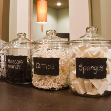 Organize things you use daily into attractive containers with creative labels.