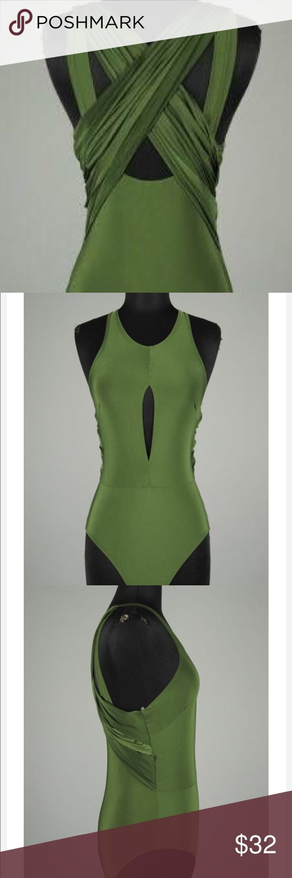 SASSY HUNTER GREEN BODYSUIT SASSY hunter green bodysuit it is! Like no other, its one of a kind! Crisscrossed in the back and a oval opening in the front.These will go fast so order yours today! #finalprice #nooffers  ​ *Only available in hunter green.   *Sizes available in small, medium and large.  *94% Polyester *6% Spandex *Made in USA. ​*100% Cute Tops