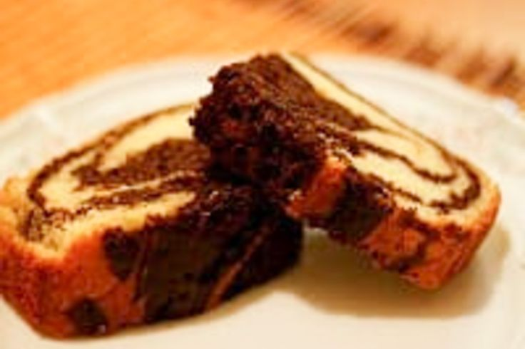 Choco Orange Eggless Marble Cake is a perfect eggless cake with lovely flavours of chocolate and orange in one. Here is how to make it.