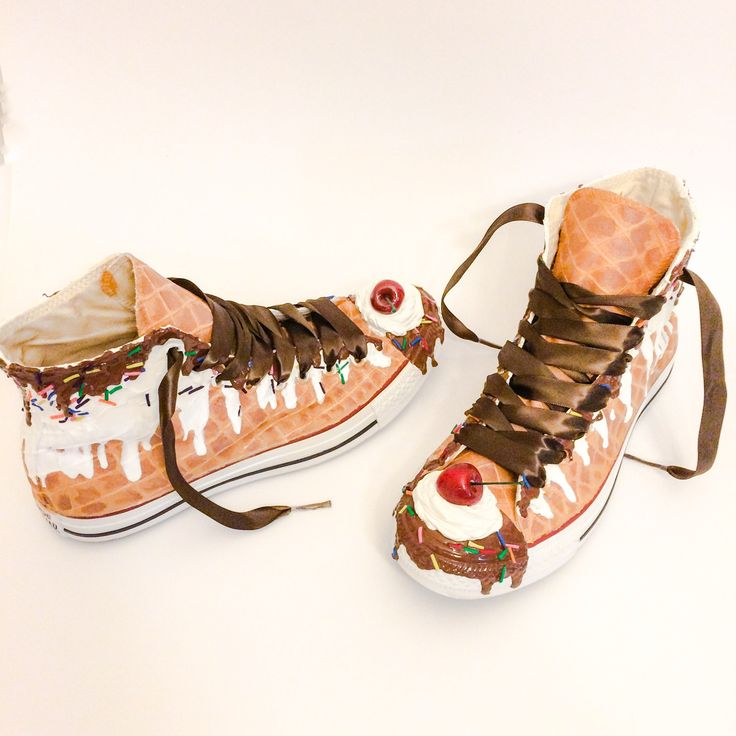 The Original Ice Cream Converse! The first of its kind and truly original and one of a kind. This pair starts out as off white (cream) converse, the tongue tab that holds the laces and the converse label are safely removed to make this design seamless. The shoes do have a realistic three dimensional texture and each and every detail is given the utmost consideration - down to the hand crafted and hand painted cherries, dollop of whipped cream and sprinkles.  The paint and ice cream are…