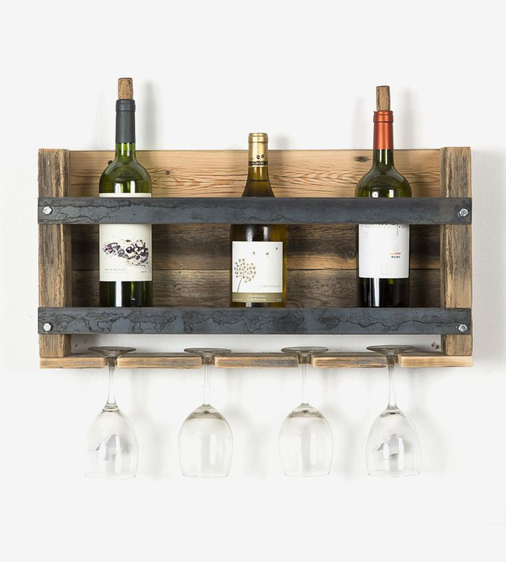Pair your reds and whites with your favorite wine glasses on this reclaimed wood and metal shelf. Crafted with raw, weathered wood, the wine rack features an open shelf with two metal bars to hold your precious bottles of vino. The industrial wine rack holds up to four glasses and bottles—one for you, plus three for friends. The weathered finish of the wood adds a rustic touch, the wood as well-aged as the wine it's holding.