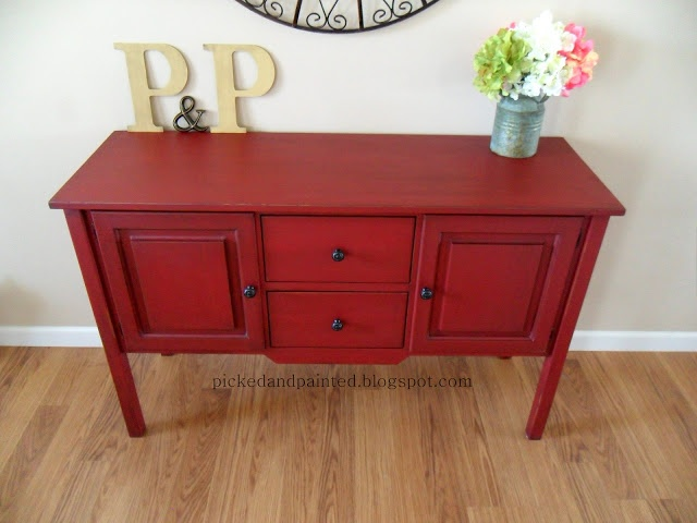 I used homemade chalk paint (1 cup latex and 1/4 cup baking soda). The paint color I used is called Posh Red by Valspar and I used a glaze to darken it a little.  I added new hardware from Hobby Lobby, distressed along the edges and and sealed with Johnson's Paste Wax.