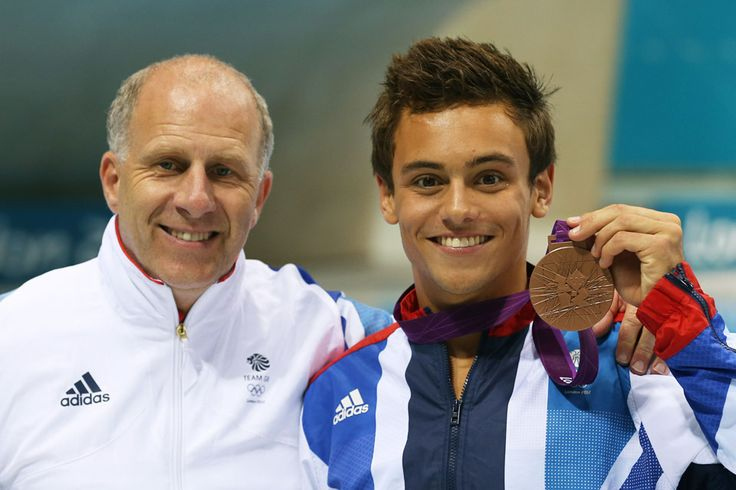 Eighteen-year-old Thomas Daley of Great Britain poses with his bronze medal and his coach Andy Banks after the men's 10m platform diving competition at the London Olympics 2012.