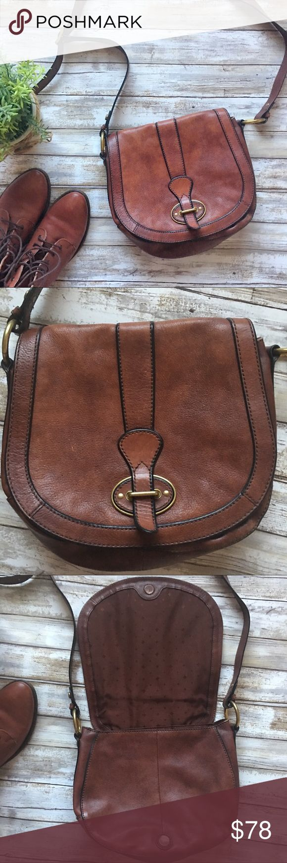 Fossil Cognac Brown Leather crossbody Purse Beautiful brown leather crossbody purse from Fossil! Gently used condition. Some minor marks but not noticeable (refer to pics for condition). Mostly on the magnetic closure there is some fading. Fossil Bags Crossbody Bags