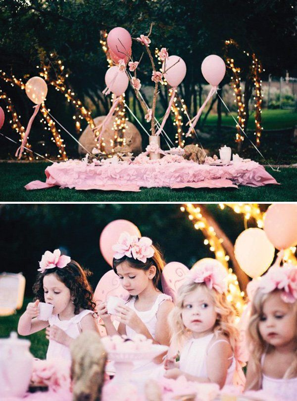 A Fairy Tea Party with pink decor and wings, twinkly lights, diy balloon arch & flower seats, pink cakes, a tea party, gold glittered decor & a woodland venue