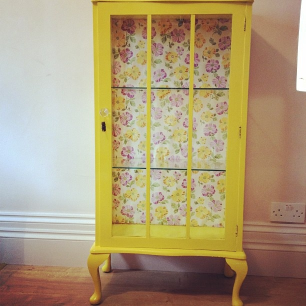 Yellow cabinet, seriously cool, enjoying the flower background too ** furniture to sell **