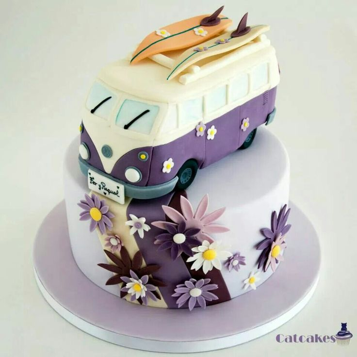 purple vw bus cake with surf boards
