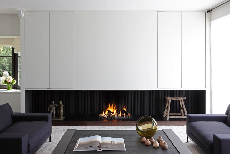 Fireplace with white integrated cabinets