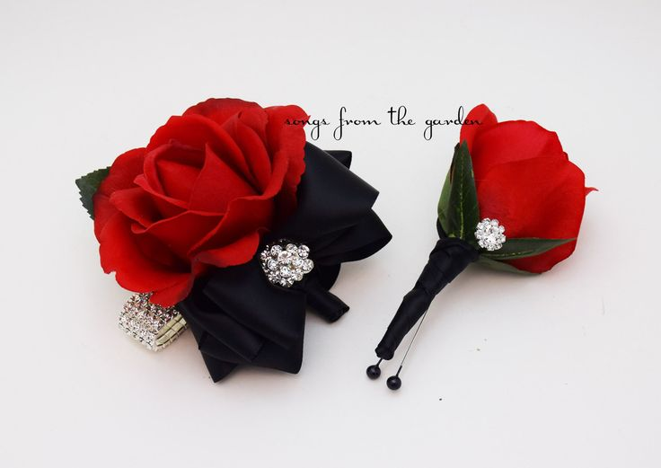 For the mother and father of the bride or groom, this Real Touch rose boutonniere and corsage set is accented with rhinestone accents with black ribbon and can be customized for your color scheme. If