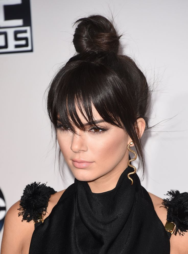 "Bangin' - dude, they're fake! Kendall Jenner showed up with a long fringe at the 2015 AMAs, but spoiler alert: it was a clip-in. ""People have asked me to get bangs and I say, 'no way,'"" the model explained on her site. ""Thankfully, faux-fringe is always a good solution."""