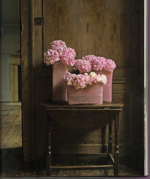 pink hydrangeas in pink vases