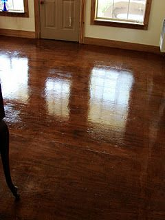 plywood floors, stained and with a coat of Polyurethane.  We love them since they are so easy to care for