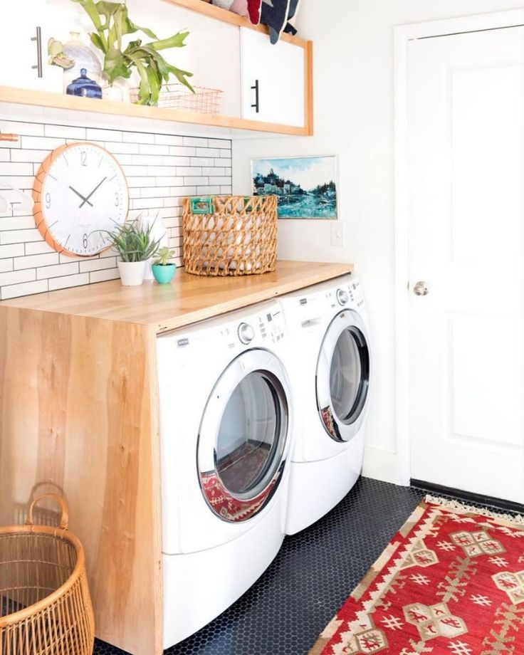 Love this boho laundry room with a DIY waterfall edge countertop.