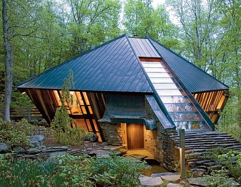 Tower forest house made of stone, wood and glass, and a copper roof, the house is in tune with nature. Architecture and interior design by Nancy Copley who was the designer and owner of this house.