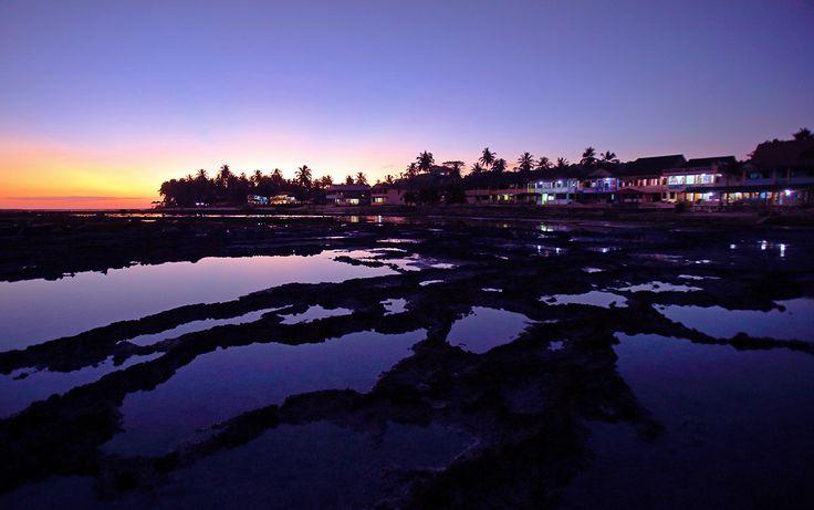 Sunset over Sorake Beach in Lagundri Bay. Nias Island, North Sumatra, Indonesia. Photo by Bjorn Svensson. www.visitniasisland.com