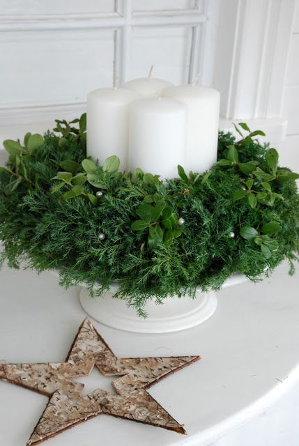Christmas Decor ~ garland of soft juniper, old cake dish, four candles in the middle