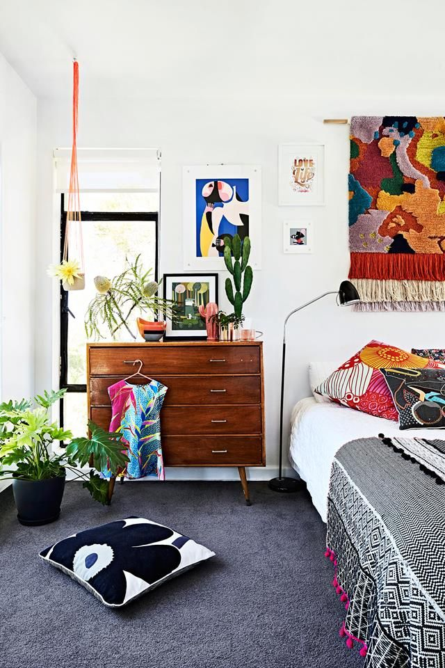 A colourful and eclectic guest bedroom from a mid-century home in Beaumaris, Victoria. Photography: Mike Barker | Styling: Paige Anderson