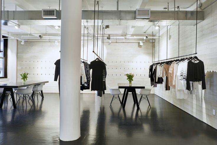 EOA  / ELMSLIE OSLER ARCHITECT,  Kendall + Kylie, showroom, NYC,  whitewashed Wood, blackened steel fixtures, custom tables