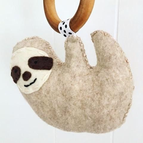 Wouldn't your happy baby like a sweet and smiling handmade sloth teether?