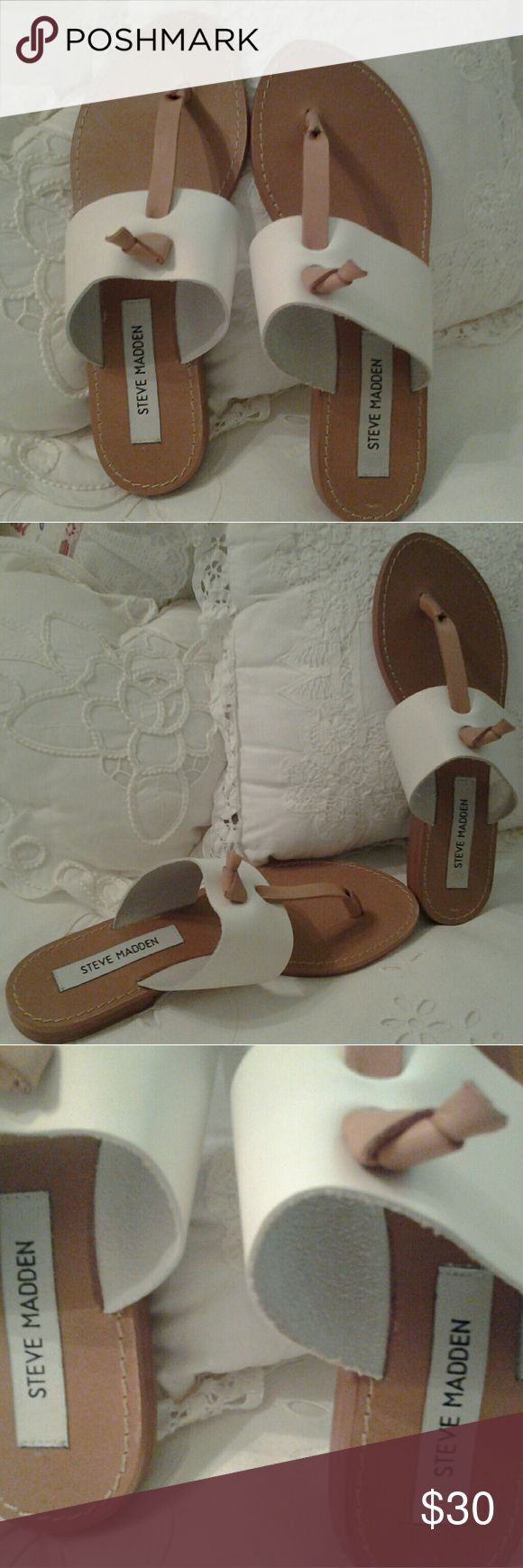 "STEVE MADDEN OLIVIA WHITE LEATHER NWT SANDAL  6 I HAVE A BRAND NEW PAIR OF STEVE MADDEN ""OLIVIA"" WHITE/ BROWN SANDALS FOR SALE.  THEY HAVE NEVER BEEN WORN, THE TAGS ARE STILL ON THE BOTTOM $59.00/  THEY ARE SIZE 6 MEDIUM  THEY HAVE LEATHER UPPER / SOCK AND RUBBER OUT SOLE.  THEY WERE MADE IN BRAZIL.  IF YOU HAVE ANY QUESTIONS, PLEASE ASK. THANKS Steve Madden Shoes Sandals"