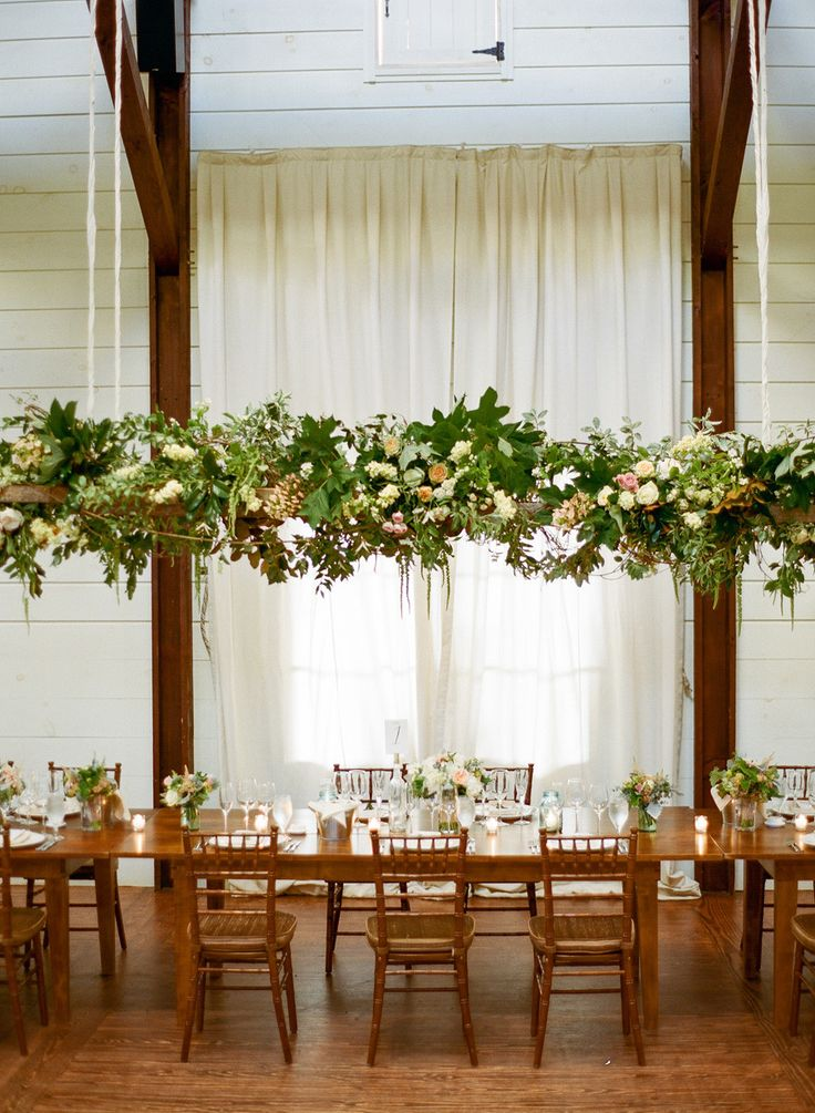 Let's do a rustic hanging floral arrangement in place of an alter (but a little more untamed than this and same vibe as my bouquet). I'd love to discretely move this into the reception over one of the tables during cocktail hour.