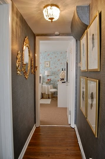 beautiful gray hallway with gold accents
