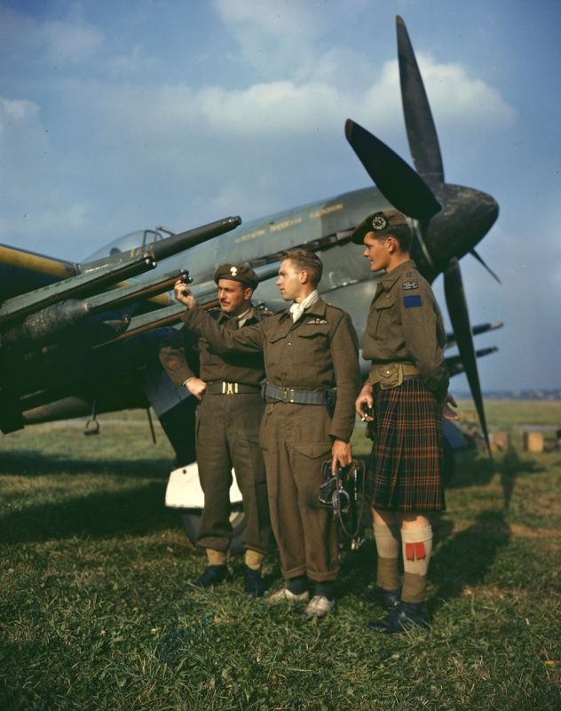 "Canadian fighter pilots in Hawker ""Typhoon Mk.IB on airfield."