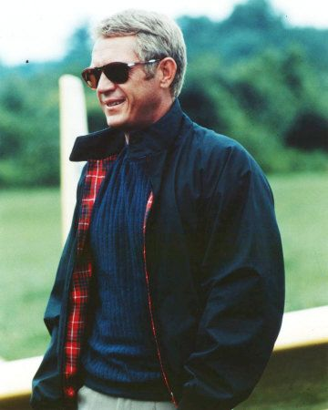 steve mcqueen in a dark navy classic Baracuta G-9 Harrington jacket. made in the UK and worth the money.