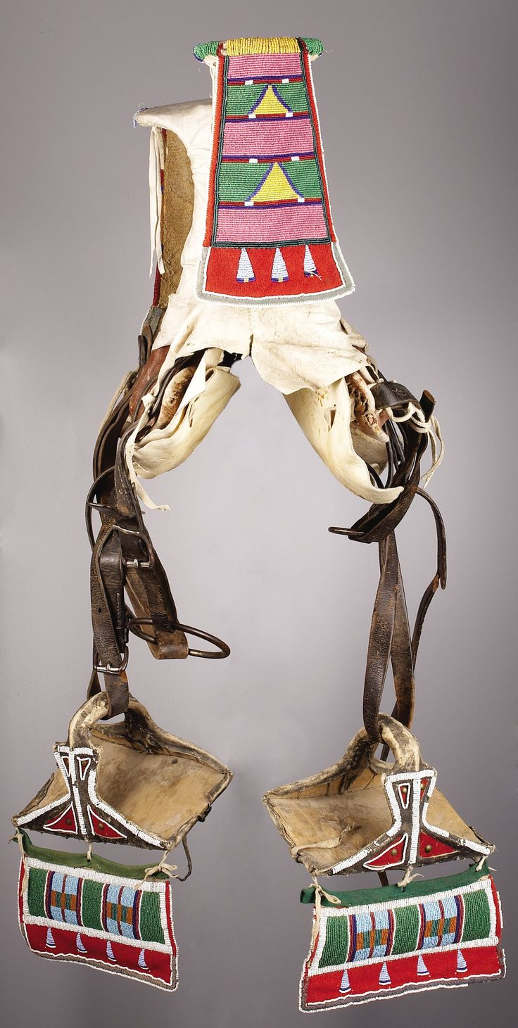 A CROW WOMAN'S BEADED HIDE PARADE SADDLE. c. 1900. ... American   Lot #77301   Heritage Auctions