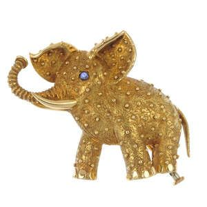 LOT:254 | CARTIER - a mid 20th century sapphire accent elephant brooch.