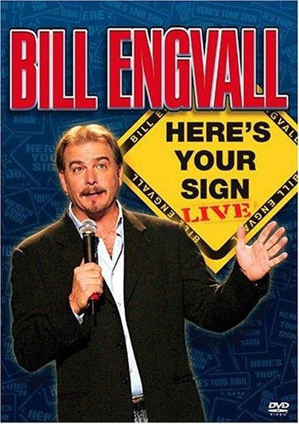 25) Bill Engvall stands at back wall midway between two corner where bedding starts. He has MANGO KNEES that help him mountain climb the bedding shelves. He almost reaches too but slips and falls back. Creates avalanche of bedding.