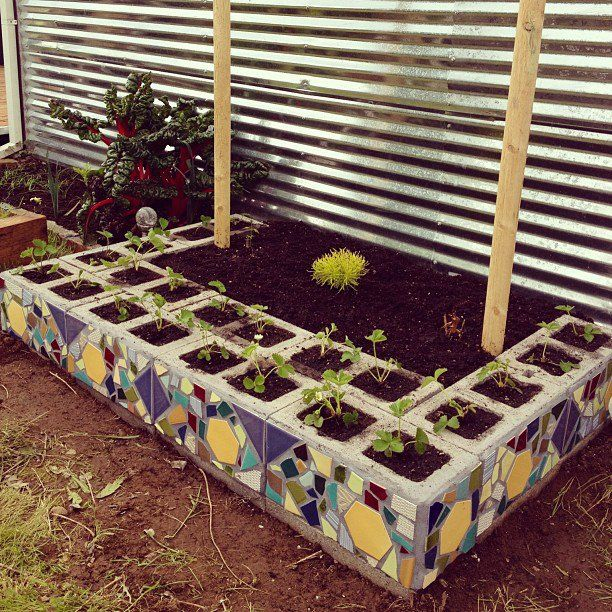 """Concrete Mosaic Planter: I like the pattern in the tiles repeated on the blocks. Usually, I don't like cinder block crafts. Kinda like repurposed tire stuff...""""that's nice, but it still looks ugly."""" On this, once the plants are big you wouldn't see it was made of cinder block."""