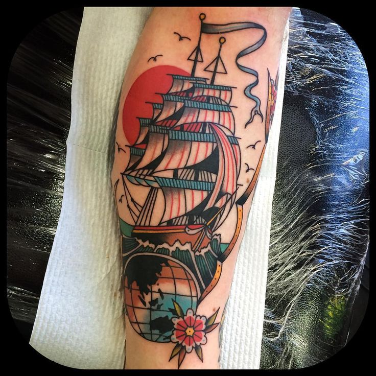 Ship and globe, travel tattoo (inside calf) by Leonie New, Melbourne