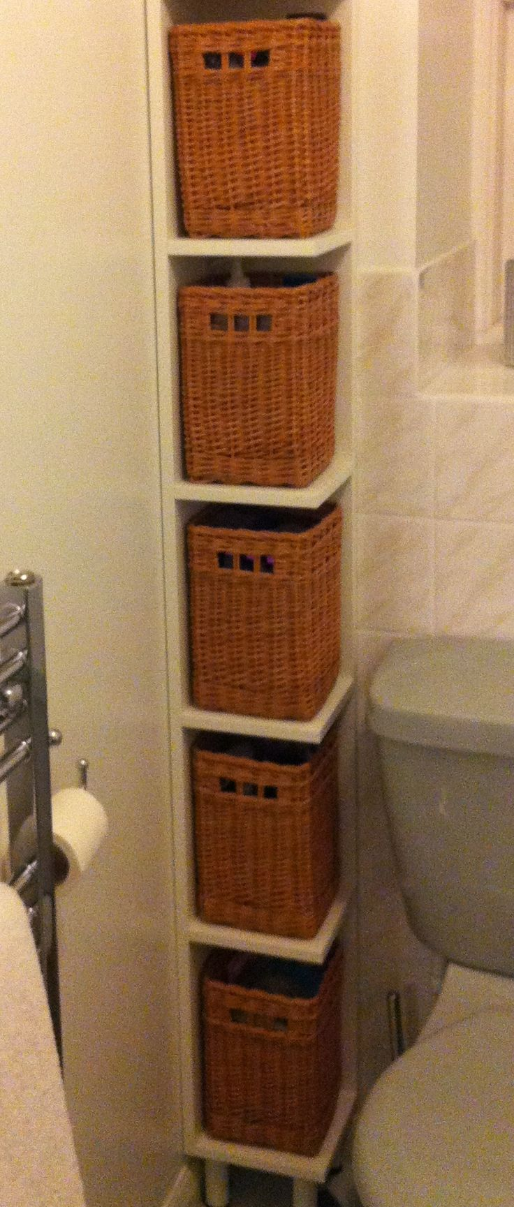 close up of the bathroom shelves with baskets. Black Bedroom Furniture Sets. Home Design Ideas