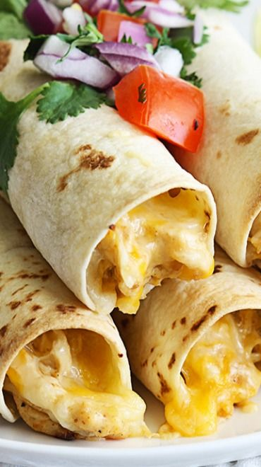 Slow Cooker Cream Cheese Chicken Taquitos Recipe ~ Flavorful creamy chicken made in the slow cooker, then rolled up in soft tortillas and baked or a few minutes until crispy!