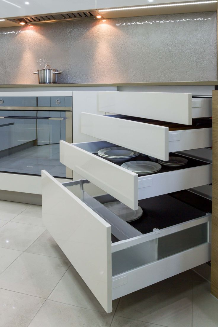 Sophisticated, handle-less kitchen in our Blackburn Showroom. www.thekitchendesigncentre.com.au @thekitchen_designcentre