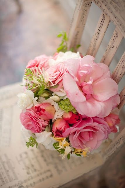 pink and green bouquet    Looks like handwritten words on an old beige…