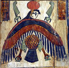 A representation of Horus, the falcon God of the Egyptians, in his solar aspect. Horus was the protector God of the Egyptian Pharaoh, and represented the King's divine authority. The common depiction of the American Eagle mascot is modelled on this image.  spacer