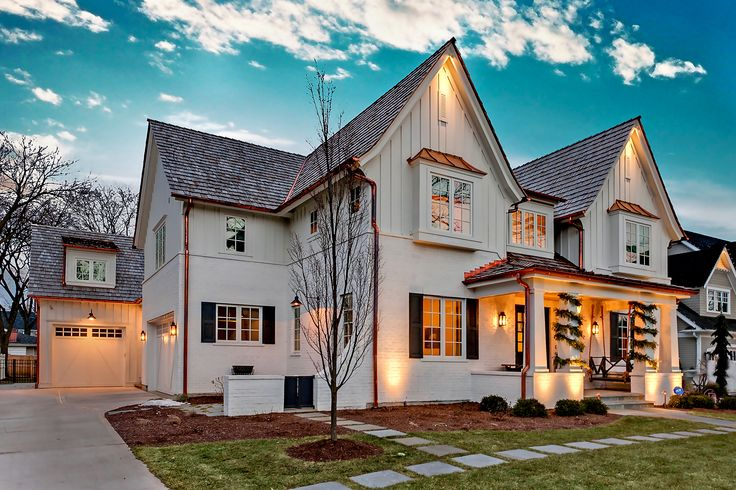 White Painted Brick And Board And Batten Siding Home Double Gable With Copper Accents And Front