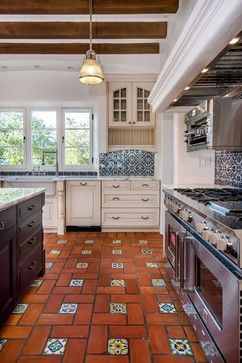 I like this Spanish style kitchen because it feels light and open but still has some pops of color.