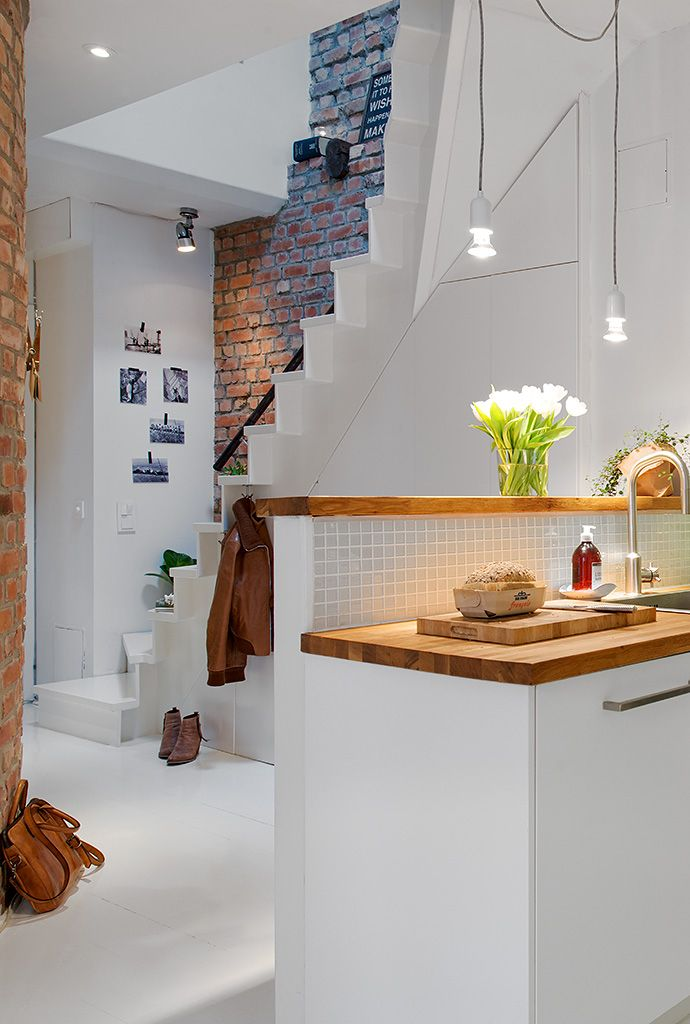 white,bricks + pendants lights