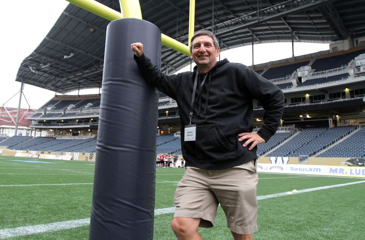 Robert Dawson poses for pic on the field at the University of Manitoba Kinesiology-Recreation, Bison Sports and Rec Services open-house event at Investors Group Field at the U of M on Sept. 26, 2013. Photo by Jason Halstead