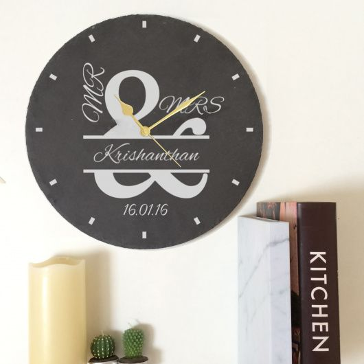 Mr & Mrs Ampersand Slate Clock.  Beautiful personalised slate clock, ideal for the lovely couple who have just got married!  The words 'MR And MRS' are fixed. You can then personalise with a surname up to 15 characters in length. Below you can then add a date up to 8 characters. All personalisation is case sensitive and will appear as entered.